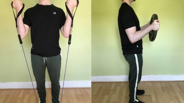 A man doing a beginner bicep workout at home