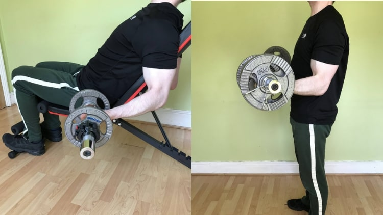 A man showing some of the best bicep exercises for mass that you can do at the gym