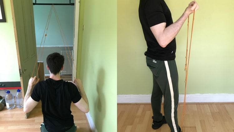 A man performing a back and bicep workout at home