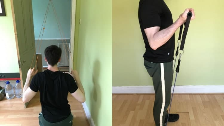 A man performing a back and bicep resistance band workout