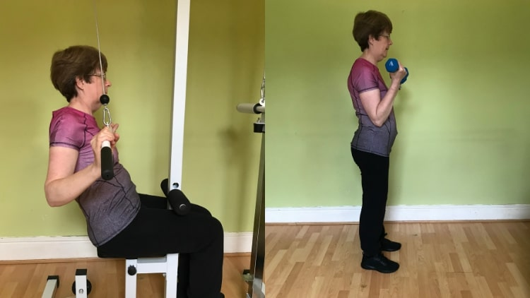 A woman performing a female back and bicep workout