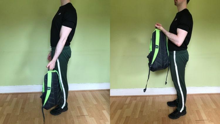A man performing backpack bicep curls