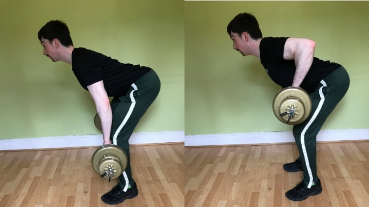 A man performing a bent over barbell row