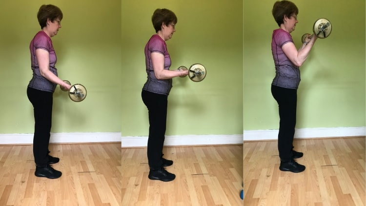 A lady performing bicep curl 21s