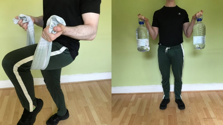 A man doing bicep exercises with no weights or gym equipment