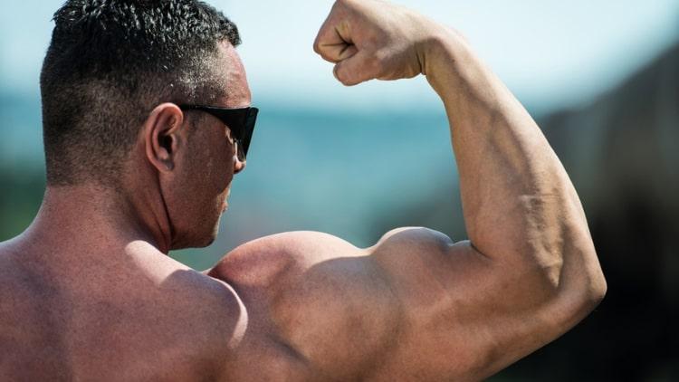 A man flexing after a bicep peak workout