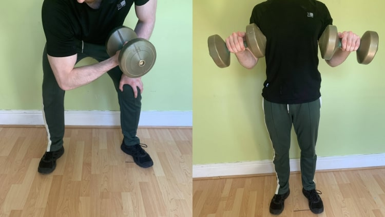 A man doing his bicep workout at home with dumbbells