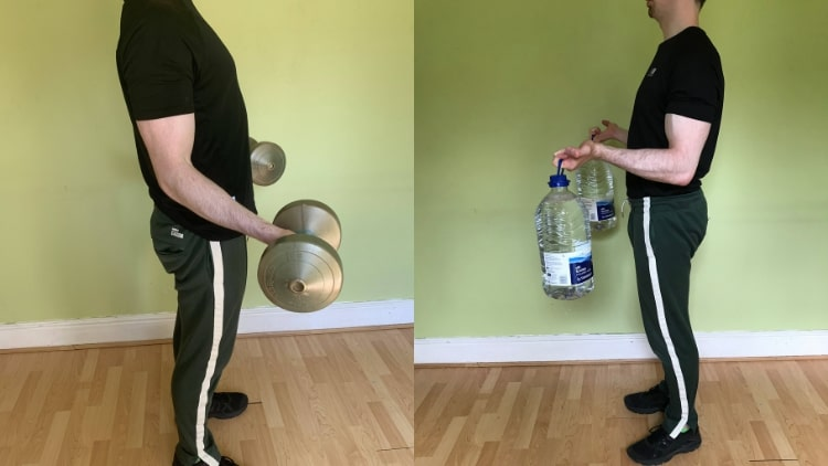 A man doing some bicep workouts at home
