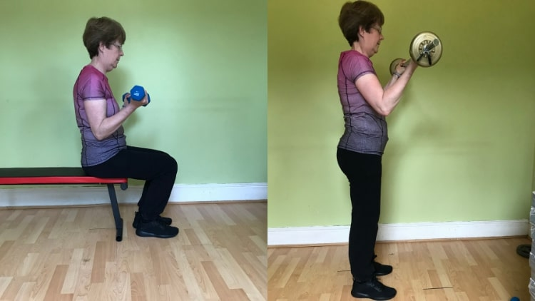 A lady demonstrating some bicep workouts for women to build muscle in their arms
