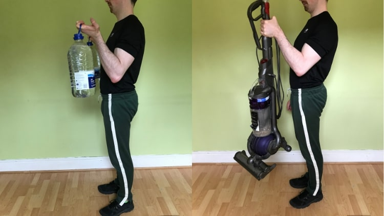 A man doing bicep workouts with no gym equipment