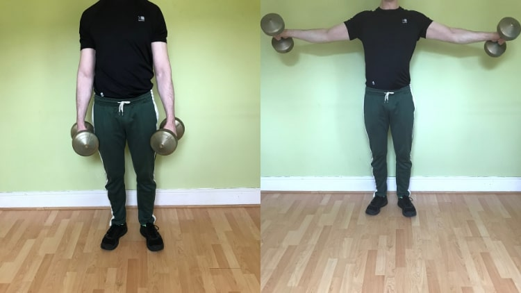 A man performing a biceps and shoulders workout