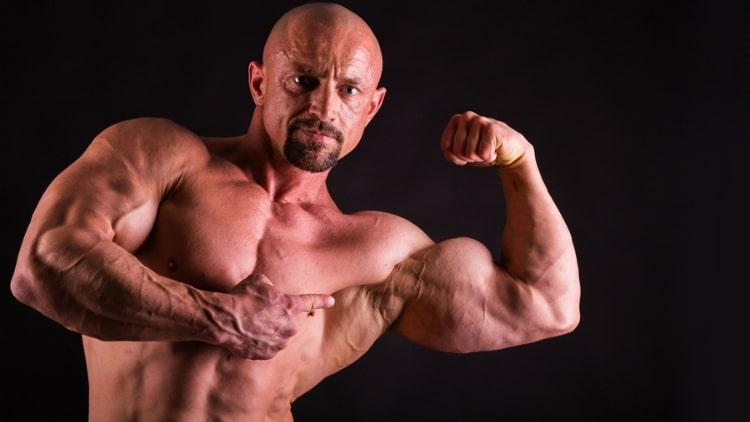 A man pointing at his biceps
