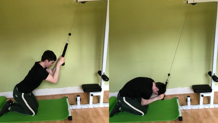A man doing a cable crunch for his abs