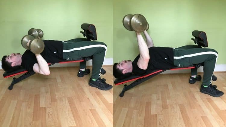 A man performing a decline dumbbell bench press