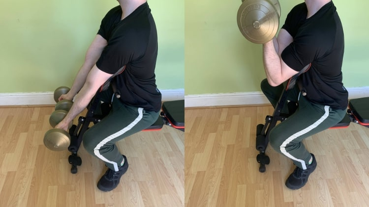 A man doing an exercise for the lower biceps