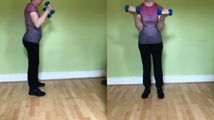 A female performing a bicep workout