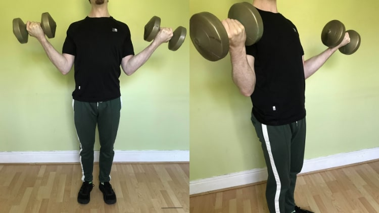 A man showing how to build the lower bicep area correctly