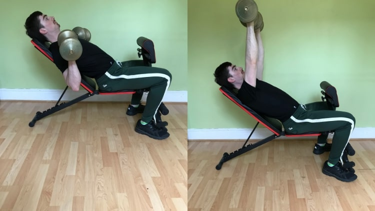 A man performing an incline dumbbell press