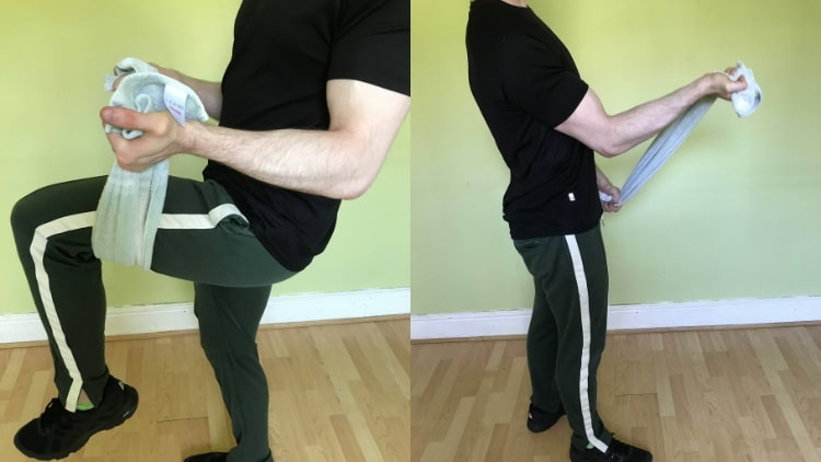 A man performing an isometric bicep hold