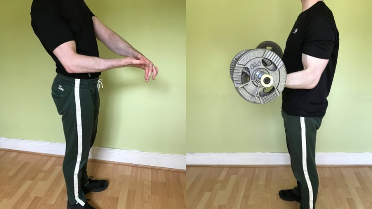 A man demonstrating some isometric biceps exercises