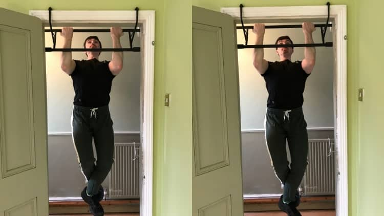 A man performing isometric chin-ups