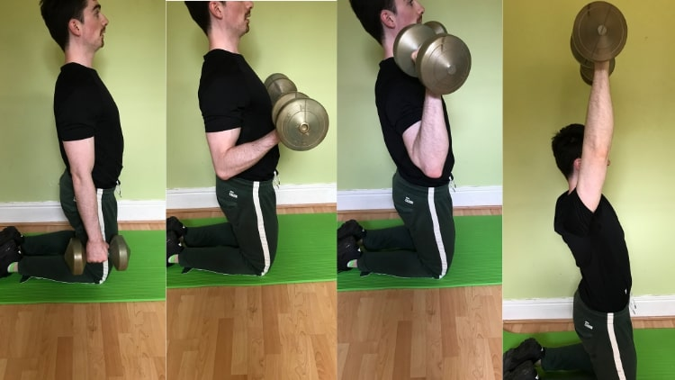 A man performing a kneeling biceps curl to overhead press