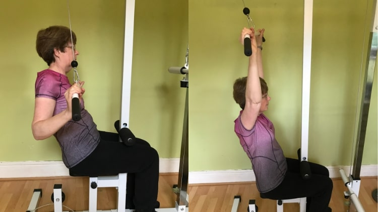 A lady performing a lat pulldown