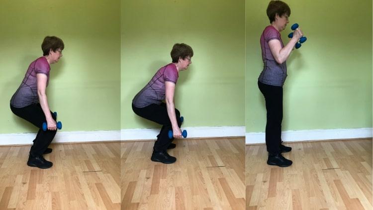A lady doing a squat bicep curl