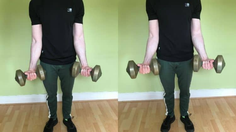 A man performing standing DB curls for his biceps