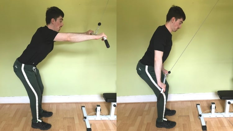 A man doing a straight arm pulldown for his lats