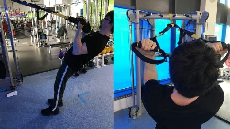 A man performing some TRX bicep exercises