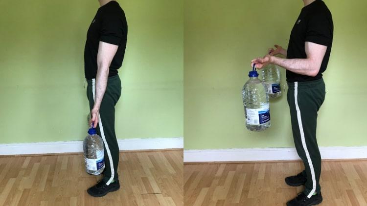 A man performing water bottle bicep curls