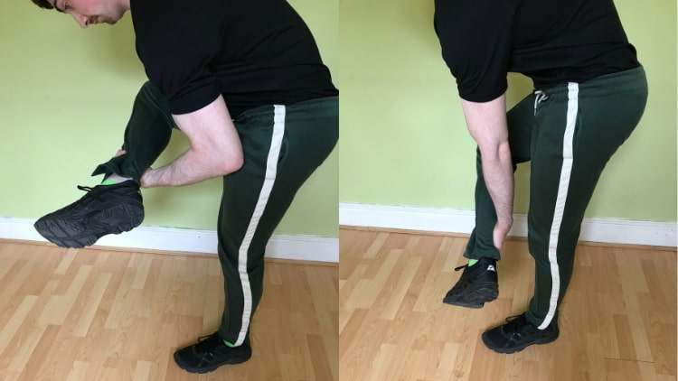 A man doing weightless bicep workouts by curling his leg