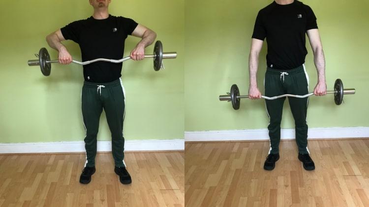 A man performing a wide grip EZ bar upright row