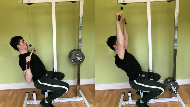 A man performing a wide grip lat pulldown