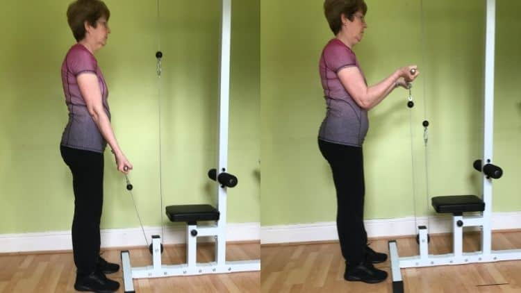 A woman performing low pullet cable bicep curls
