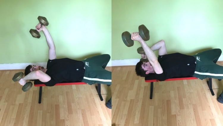 A man doing an alternate lying dumbbell extension for his triceps