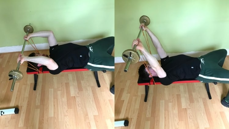 A man doing a banded barbell skull crusher