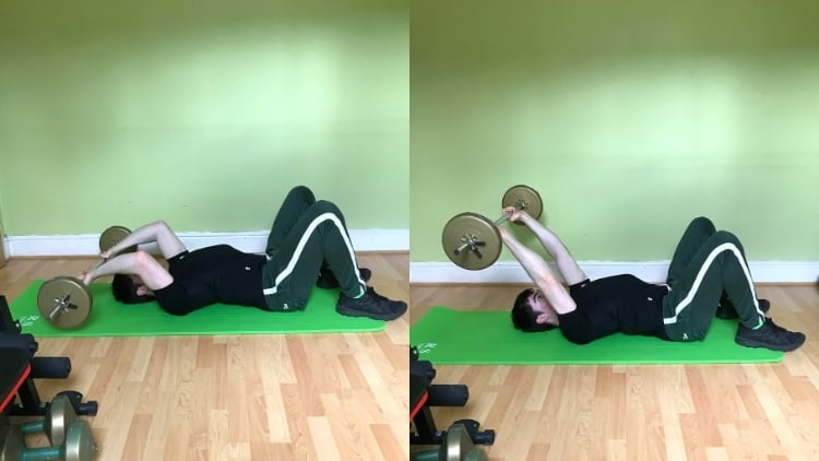 A man performing a barbell floor skull crusher