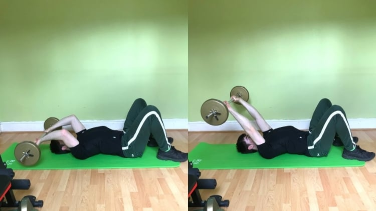 A man doing a lying barbell tricep extension on the floor