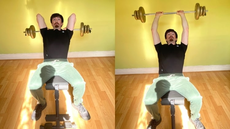 A man performing a barbell incline tricep extension