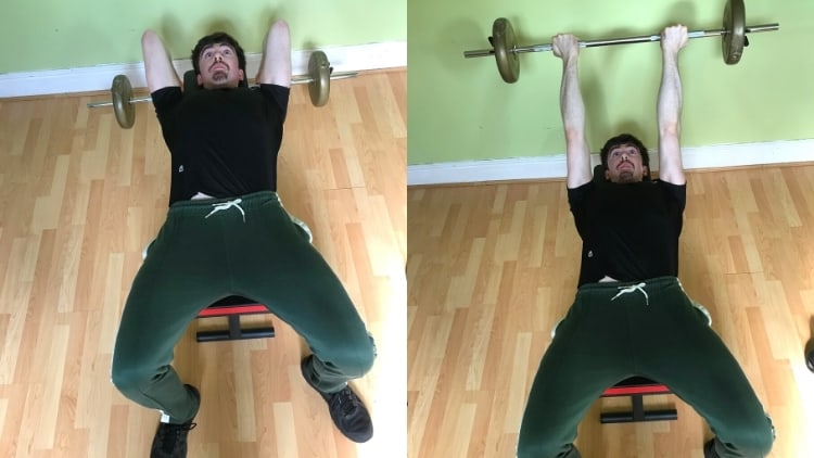 A man doing a barbell reverse grip skull crusher for his triceps