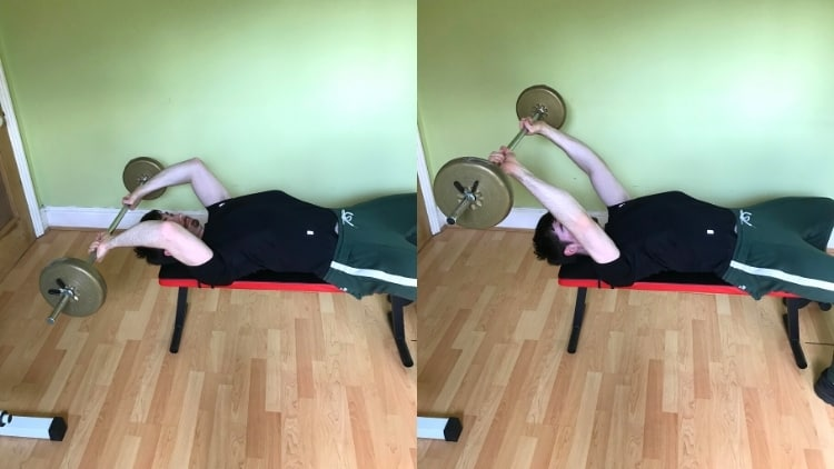 A man doing a barbell skull crusher for his triceps