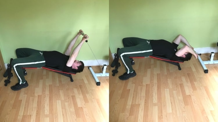 A man doing cable incline skullcrushers