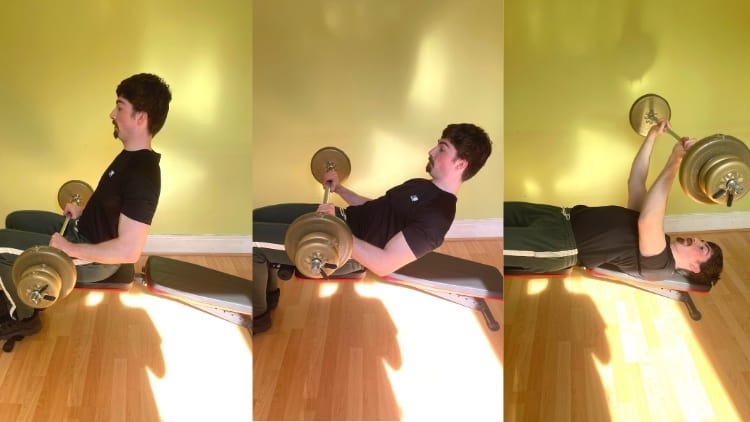 A man doing decline barbell extensions for his triceps