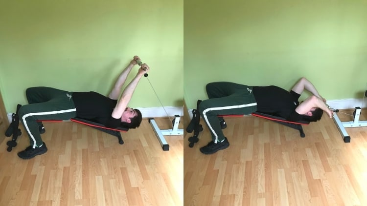 A man performing a decline cable triceps extension