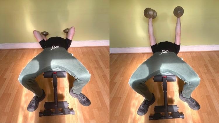 A man doing a decline DB tricep extension