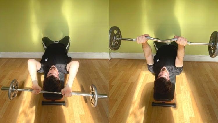 A man doing a decline EZ bar triceps extension