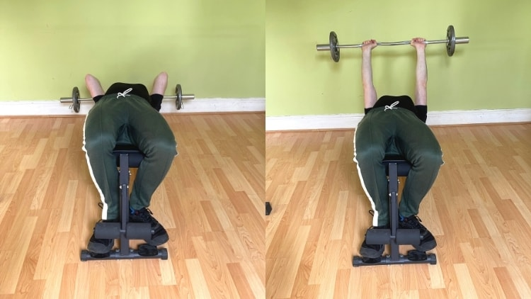 A man doing a decline EZ triceps extension