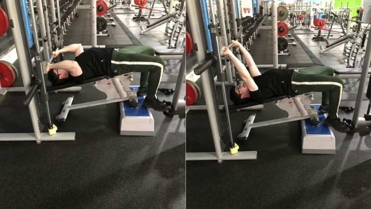 A man performing decline Smith machine skull crushers